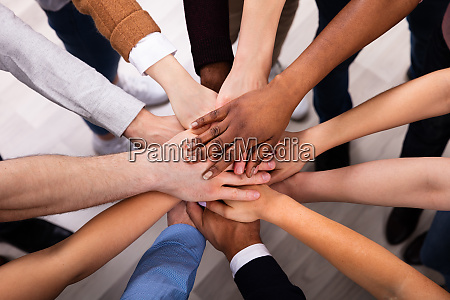 diverse people stacking hand together