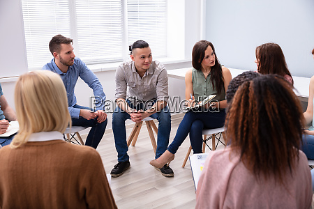 three men sitting together counseling
