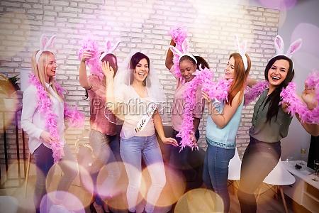 bride and bridesmaids celebrating bachelorette party