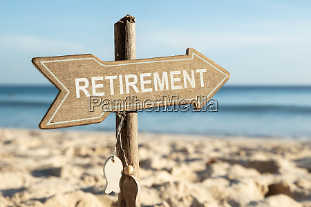 retirement directional sign on beach