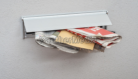 newspapers and a letter in a