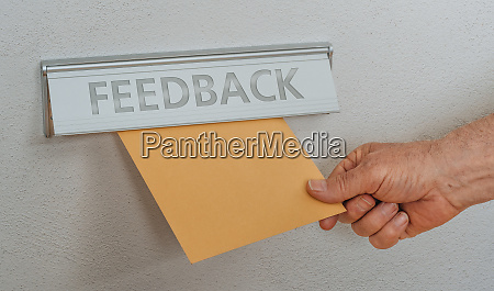 a letterbox with the inscription feedback