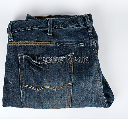 folded blue mens jeans on a