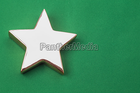 golden xmas star on green