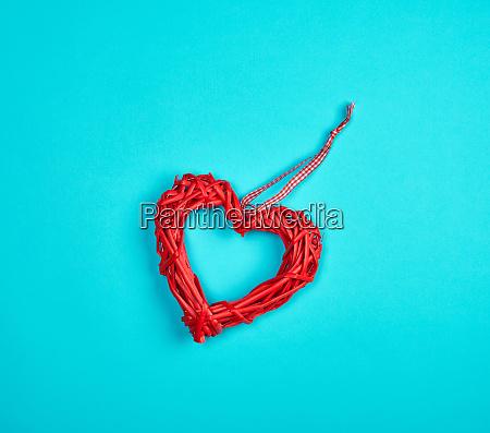 wicker red heart on a blue