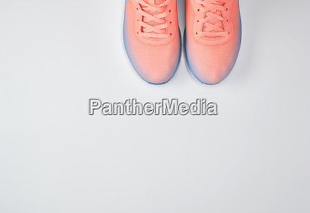 pair of pink sneakers with laces