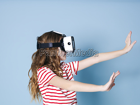 smiling positive girl wearing virtual reality