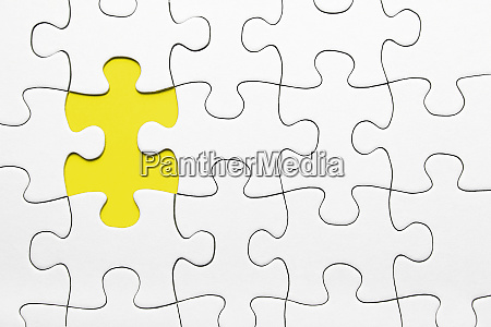 yellow puzzle piece missing business concept