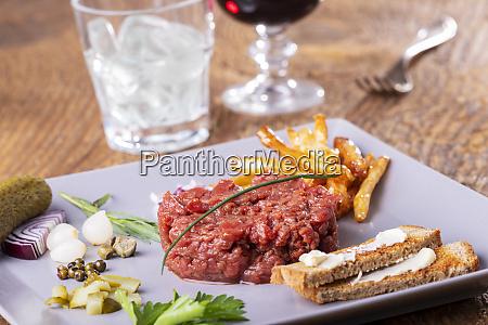 raw steak tartare on a grey