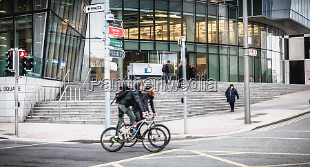 cyclists passing by the irish social