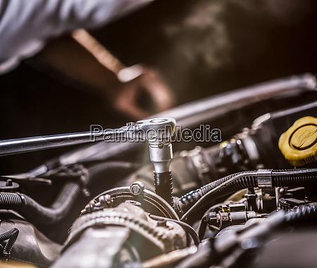 auto mechanic working in garage repair