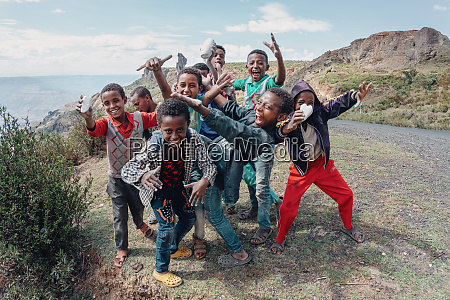 ethiopian teenager boys posing to tourists
