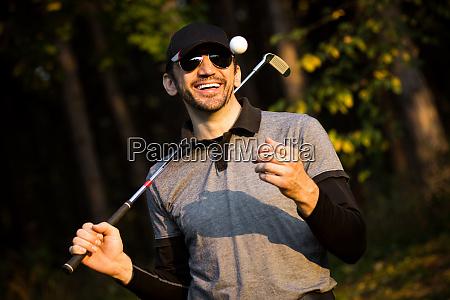 playful smiling golfer
