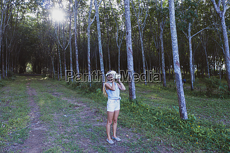 woman in the forest uses vr