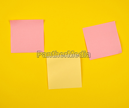 pink and yellow paper stickers pasted