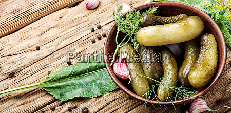 homemade pickles on wooden table
