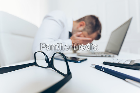 tired businessman from heavy workload