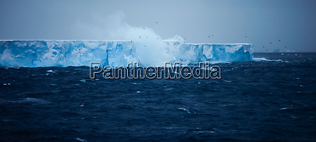 a large iceberg with steep sides