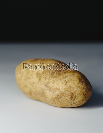 a scrubbed clean organic russet potato