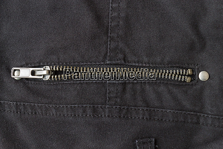 open brass zip on black jeans
