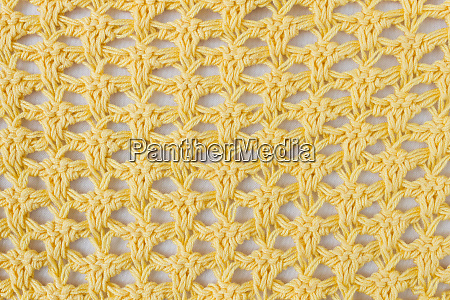 dark yellow knitting pattern or knitted
