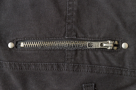 closed brass zip on black jeans