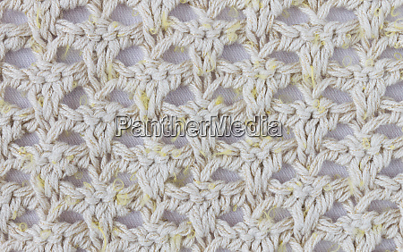 yellow knitting pattern or knitted pattern