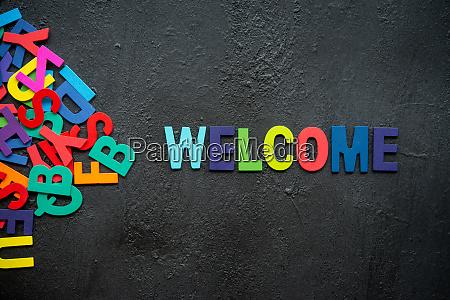welcome text on dark background