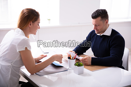 businessman interviewing female candidate
