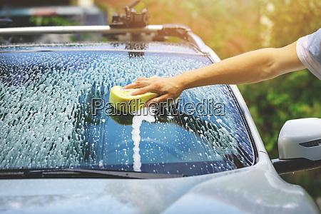 hand car wash washing windshield
