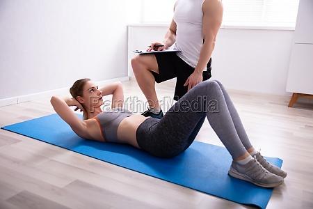 woman doing sit ups over yoga