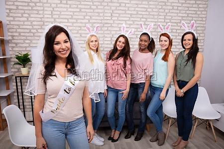 friends wearing bunny ear hair bands