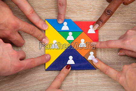 group of peoples hand on colorful