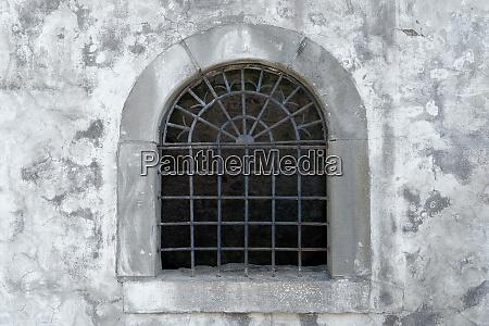old semicircular open lattice window in