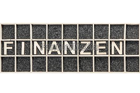 wooden letters word finanzen