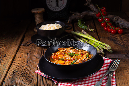 colorful turkey fricassee with asparagus and