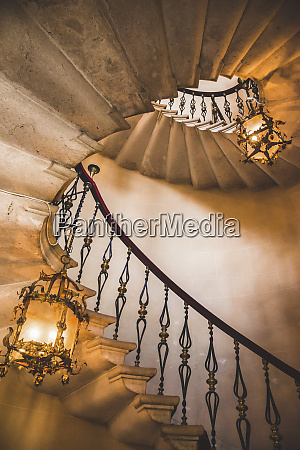 spiral staircase and chandeliers duino castle
