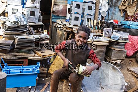 eritrean boy cutting a can at