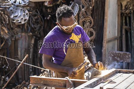welder at the medeber market where