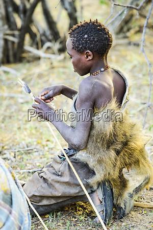 young hadzabe hunter wearing baboon skin