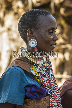 datoga woman with facial tattoos wearing