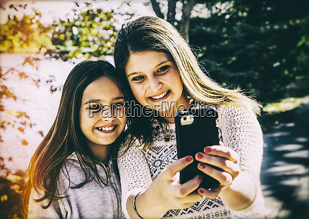 two sisters taking a self portrait