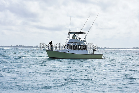 fishing boat on choppy ocean grand