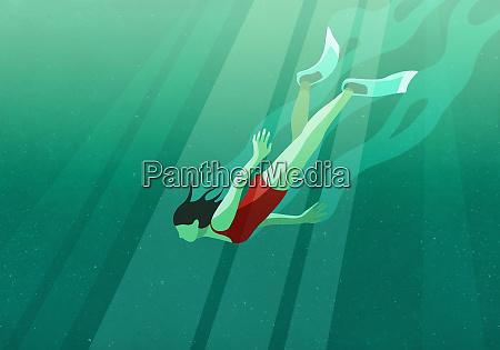 woman diving underwater in ocean