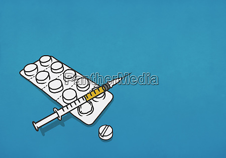 syringe and blister pack of pills