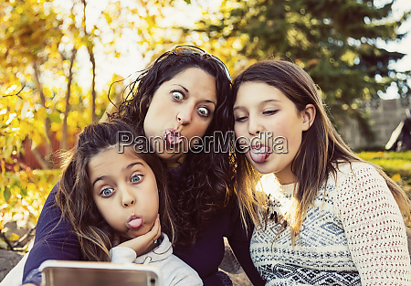a, mom, and, her, two, daughters - 27027351