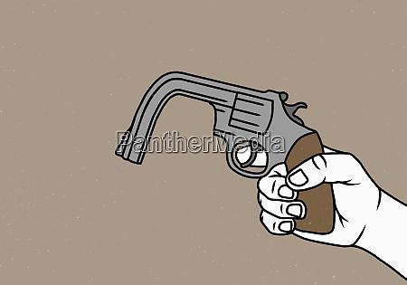 hand holding bent gun
