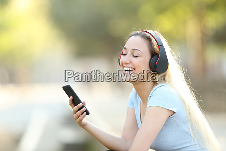 happy girl listening to music with