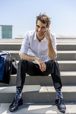 portrait of happy businessman sitting on