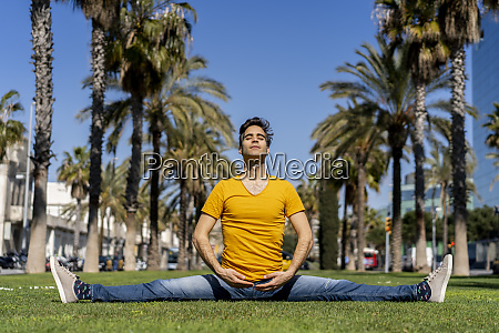 spain barcelona man practicing yoga on